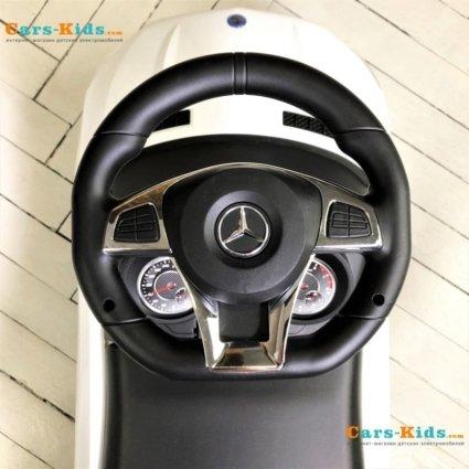 Толокар Mercedes-Benz GLE63 AMG с ручкой красный (мелодии, поворот с ручки, подножки)